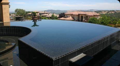 Pebble technology international jet black pebble pool finish pool finish colors pool for Pebble finishes for swimming pools