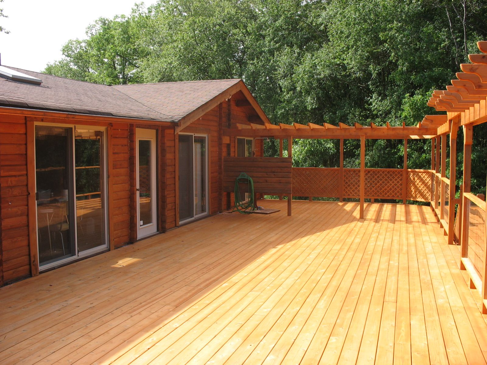 A Beautiful Cedar Log Home And Cedar Deck Restored With