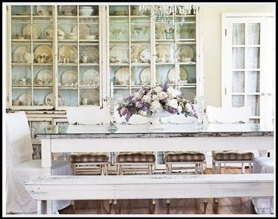 Table with a barn door with glass on top of it.