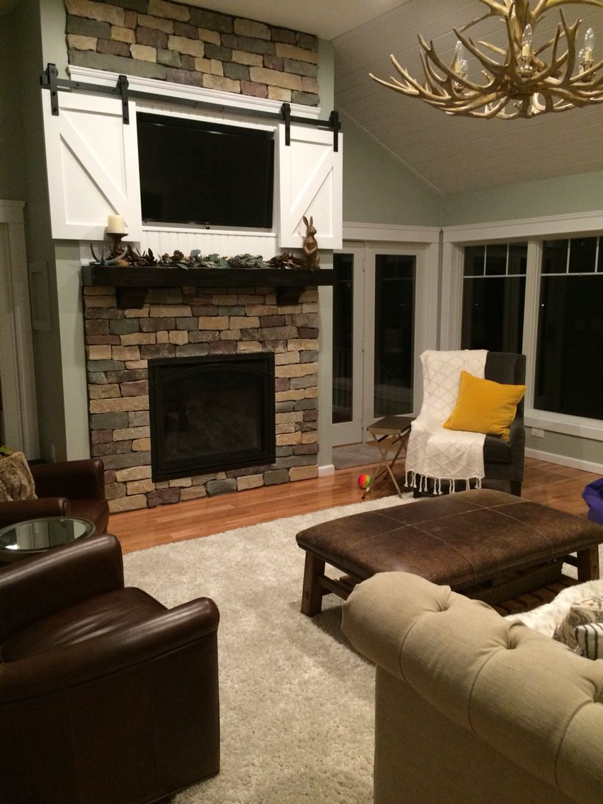 Barn Doors Above Fireplace Built In Around Fireplace Family Living Rooms Living Room With Fireplace