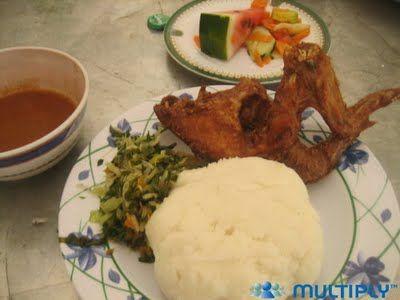 Tanzania. Ugali, chicken, greens, dipping sauce, watermelon salad.