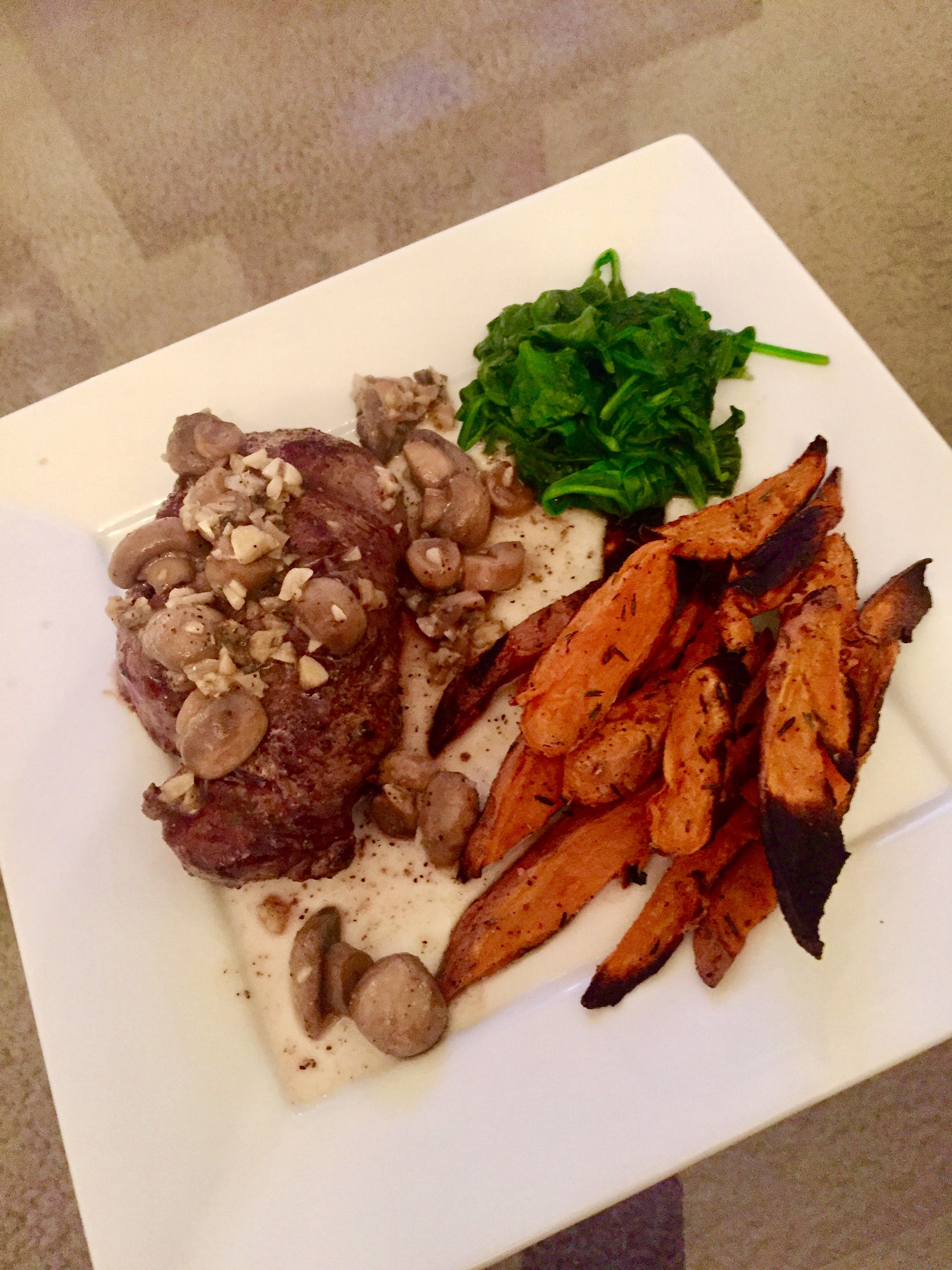 Steak with mushrooms, baked sweet potato fries and steamed spinach
