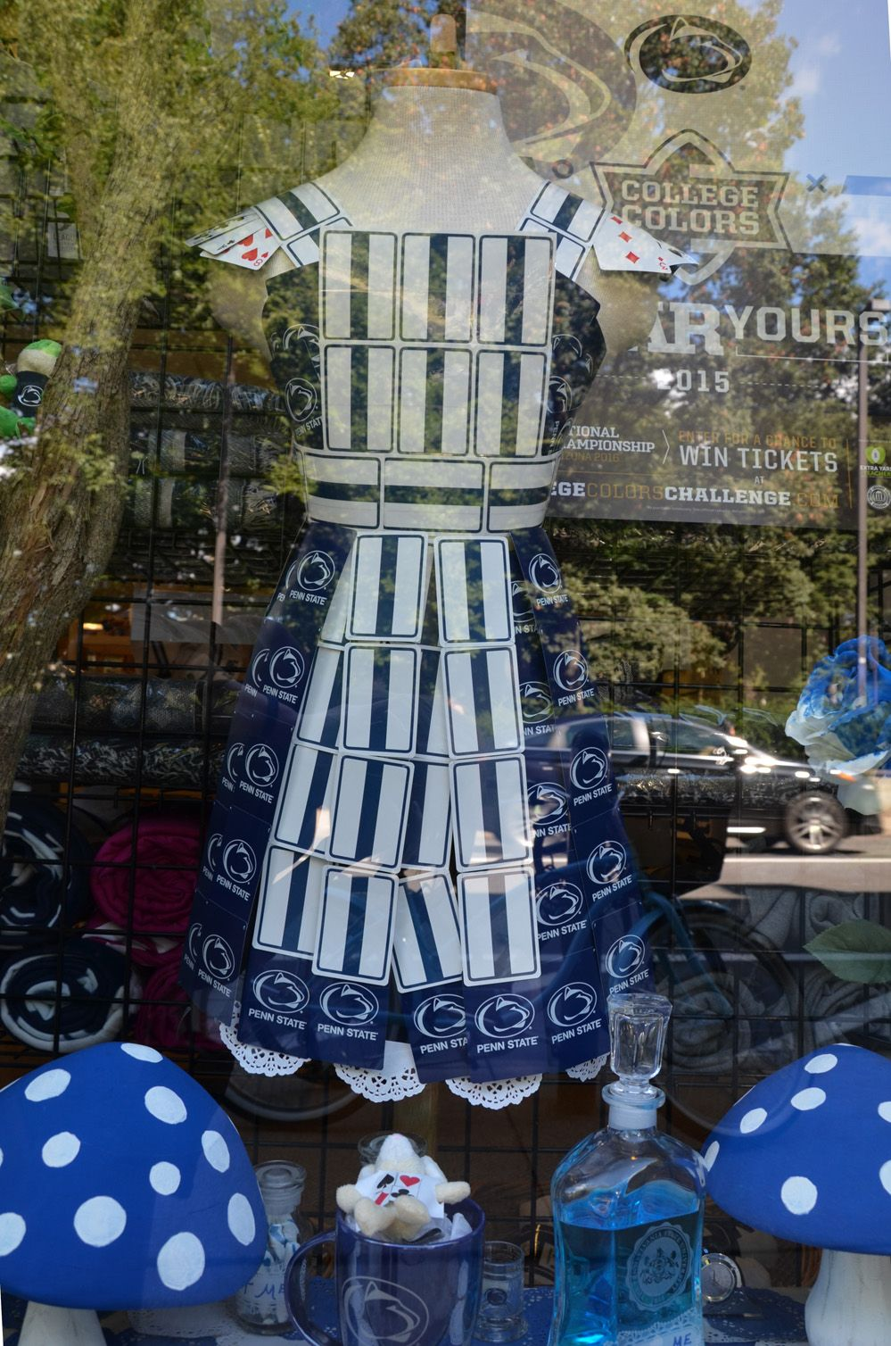 White apron in store - A Store Along College Avenue Displays An Apron Made Of Blue And White Cards And Tickets