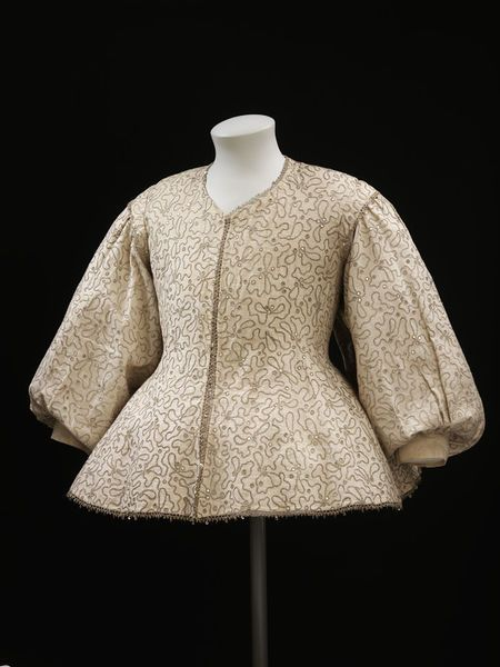 """1630-1640 British Woman's waistcoat at the Victoria and Albert Museum, London - From the curators' comments: """"The high waist and full sleeves set into the back of this waistcoat are characteristic of women's dress of the 1630s. The style of embroidery is quite unusual: a striking design of meandering lines rather than the naturalistic floral patterns typically seen on earler embellished waistcoats."""""""