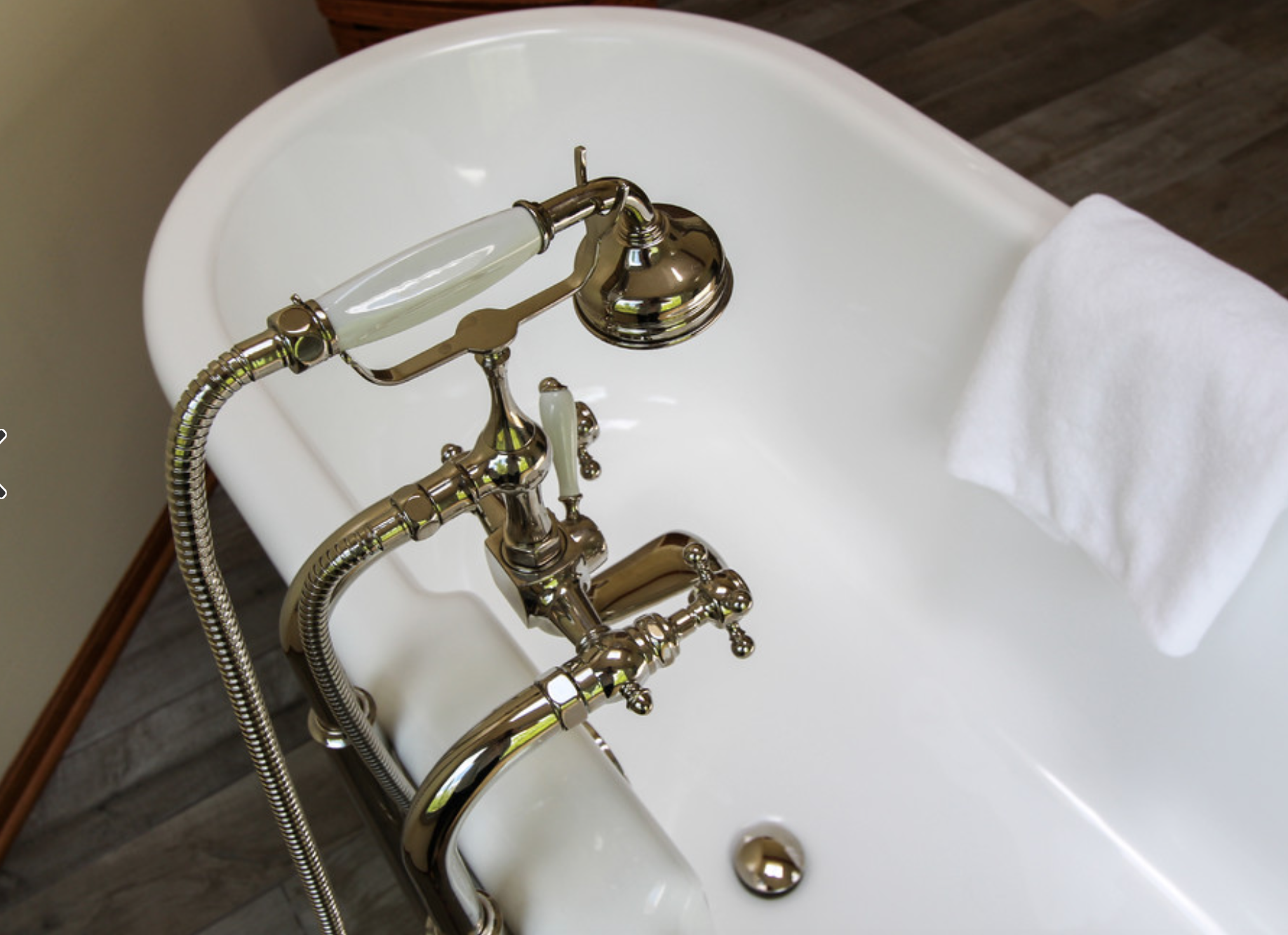 Beautiful bathtub faucet. Unique finish for an old-fashioned tub ...