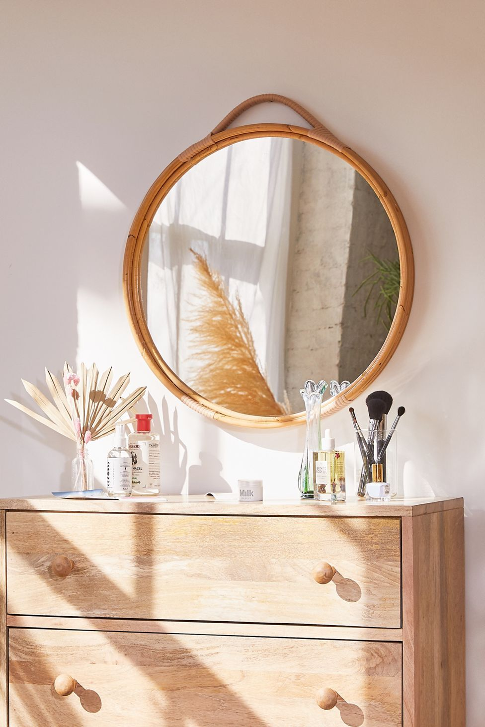 Corin rattan round wall mirror urban outfitters in 2020