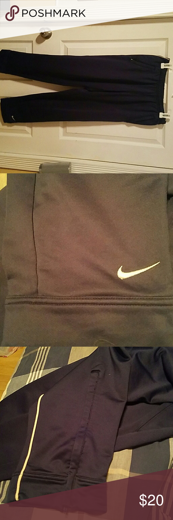 Nike Fit Dry pants Navy blue Nike Fit Dry pants. They have two pockets on the sides and they zip up as well. The bottoms zip up as well. Nike Pants Track Pants & Joggers