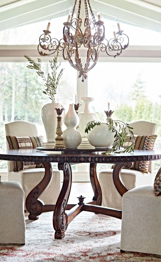 Steeped in the romance of late night meals in the mediterranean our cannes pedestal table with lazy susan is magnificent in every detail