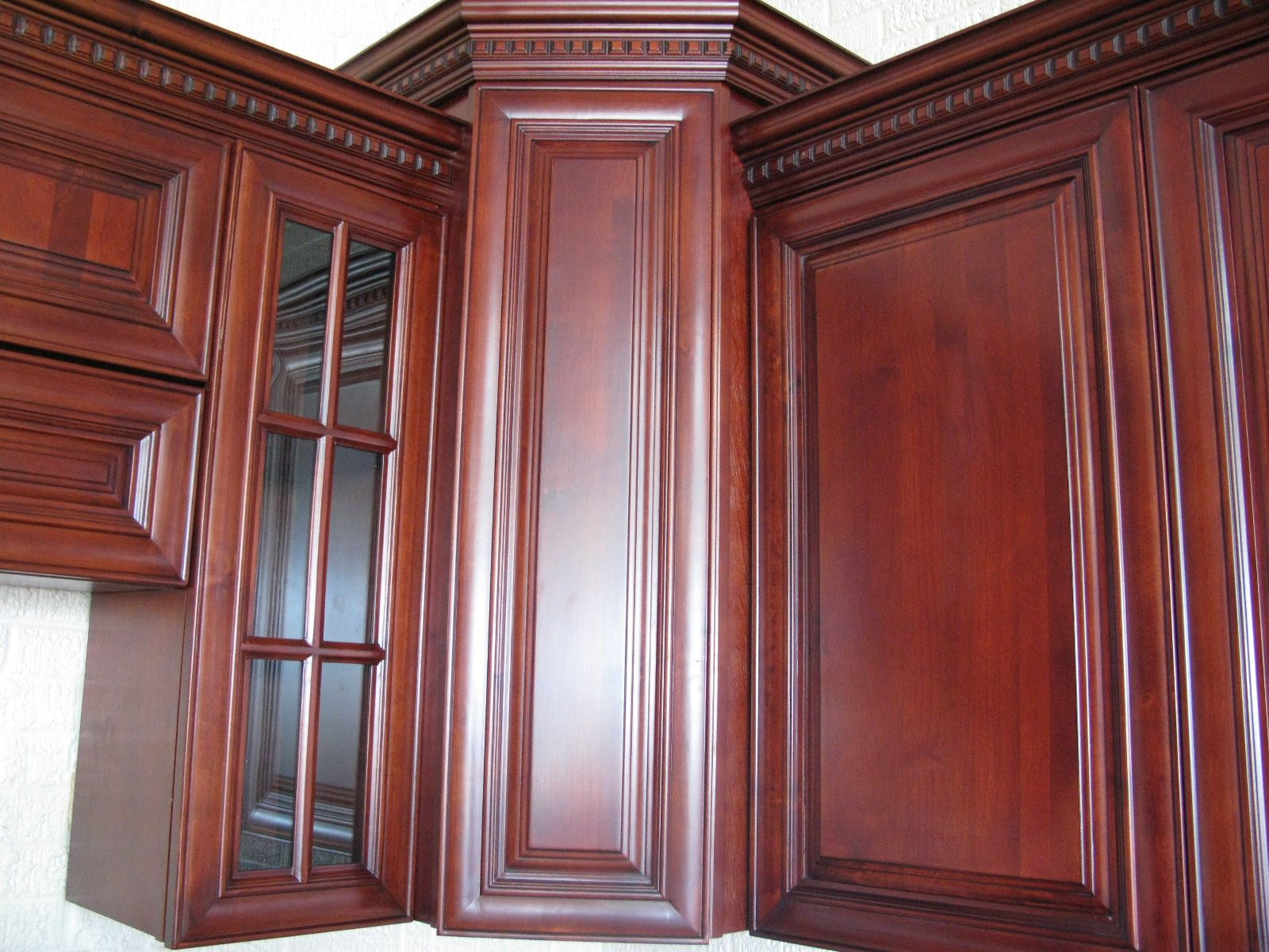 Cherry maple cabinets crown molding with dentil detail for Black kitchen cabinet doors