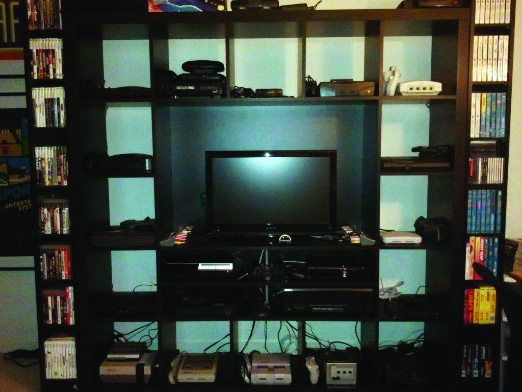 The Most Impressive Video Game Room Ideas To Enhance Your Cellar Video Game Rooms Game Console Shelf Console Shelf