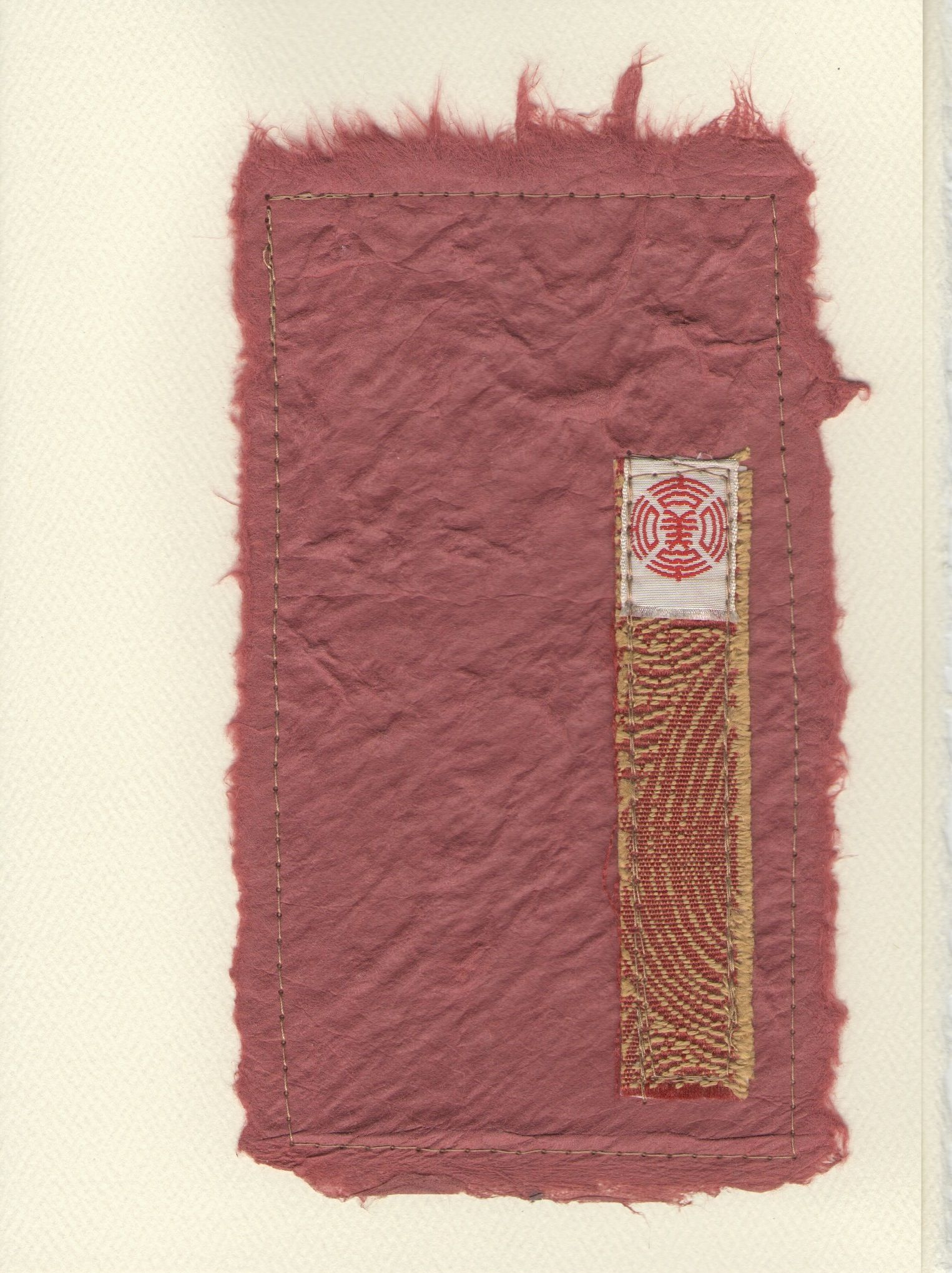 Greeting card created w/ Asian paper & found fabric & label.