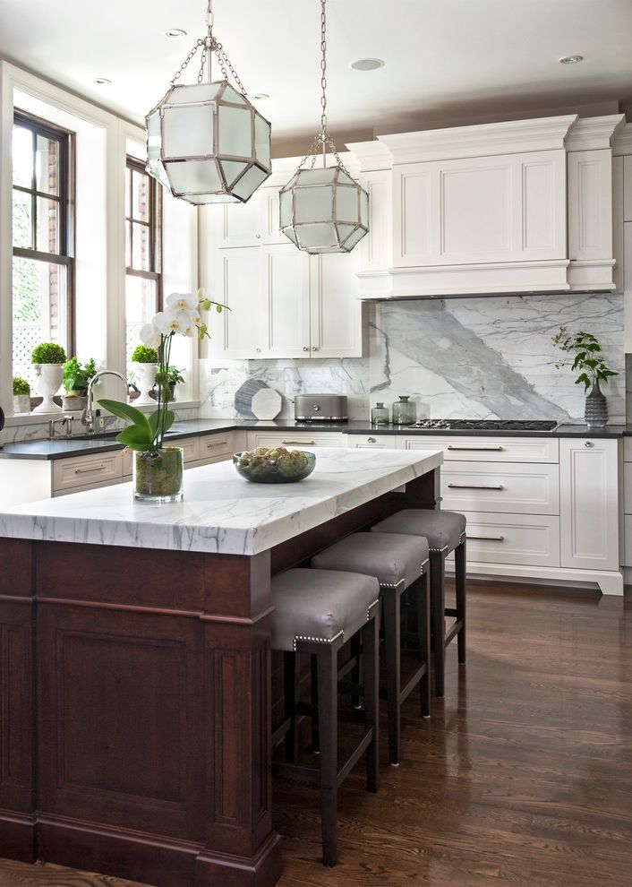 best induction range with traditional kitchen and dark wood island gray marble backsplash silver on kitchen interior top view id=67985