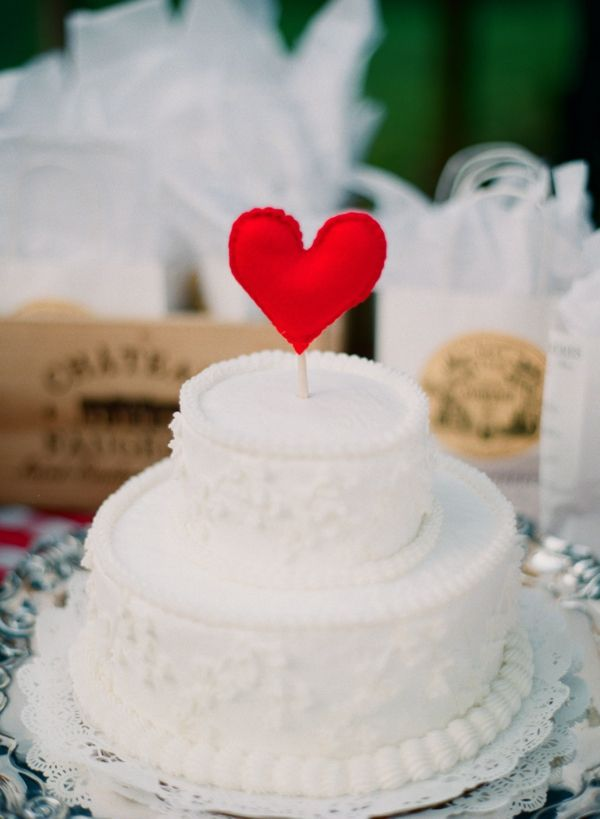 simple classic white wedding cake with red diy felt heart.