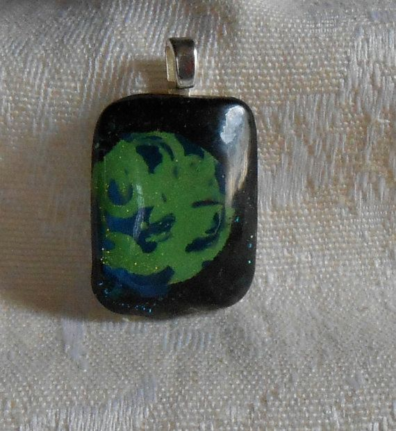 Earth floating in sea of stars pendant by BeautyOffered on Etsy, $8.00