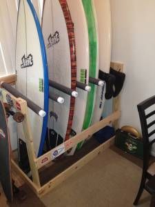 A Freestanding DIY Surfboard Rack Made From A 2x4, 1x4, PVC Pipe, And