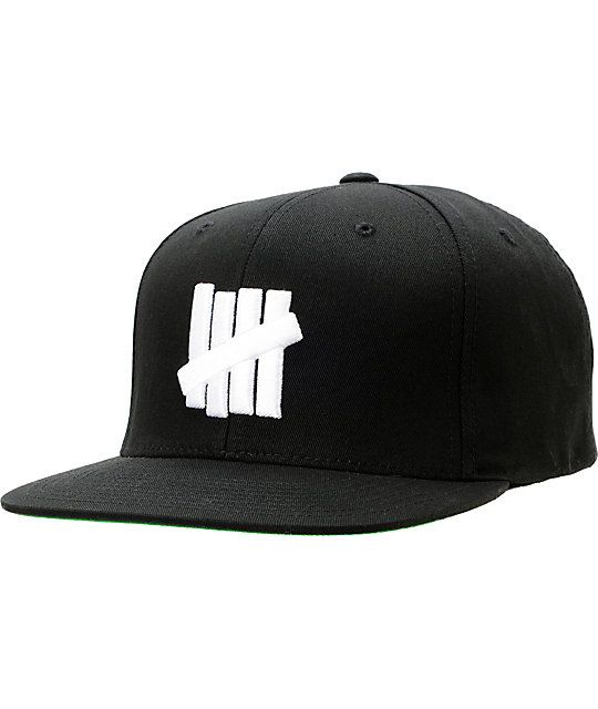 f10aca73 Keep your style tight like with the Undefeated Five Strike snapback hat in  all black. The Undefeated Five Strike snapback hat features a high quality  cotton ...