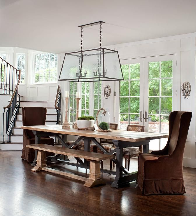 Beautiful Dining Room Features A Reclaimed Wood And Iron Dining Endearing Captain Chairs For Dining Room Design Decoration