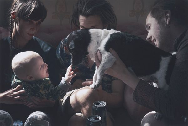 The winning image from the Taylor Wessing Photographic Portrait Prize 2014, taken by David Titlow, pictures his son Konrad being introduced to a dog