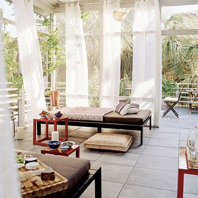 Perfect Backyard Paradise   An Outdoor Lounging Space Surrounded By Island Palms Is  Inherently Romantic; Fiery Bursts Of Red And Sheer Curtains Only Add To The  ...