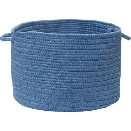 Store outdoor accessories on the porch or towels in your powder room with this chic utility basket, showcasing a braided design in a blue ice hue.