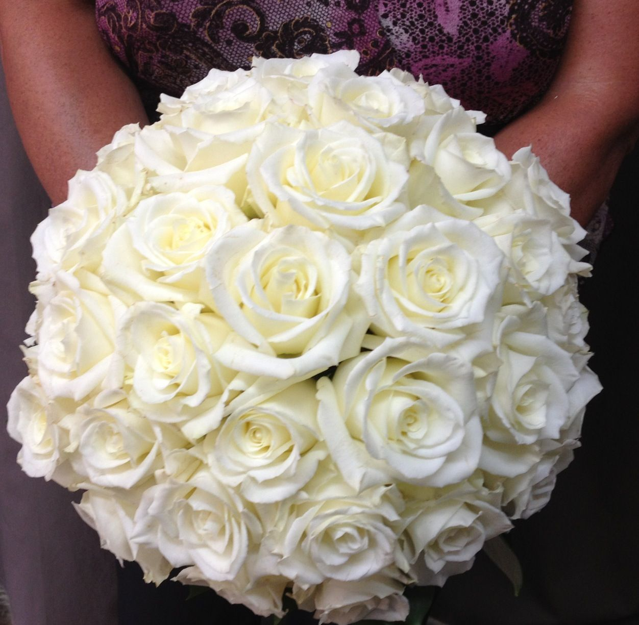 Wedding bouquets not flowers  Beautiful and elegant wedding bouquet All white roses makes for a