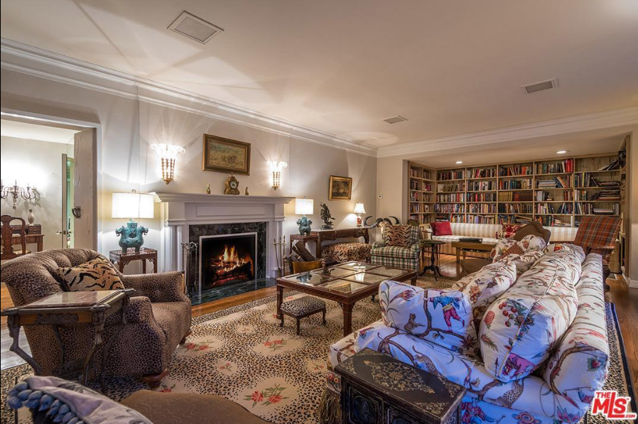 The living space includes six bedrooms along with a living room, family room, formal dining room, kitchen, and breakfast room. - TownandCountrymag.com
