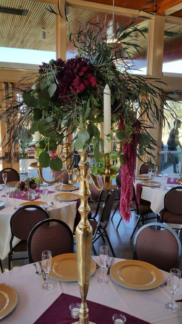 Tall messy green and burgundy centerpiece on gold