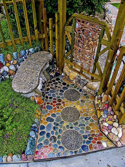 Not sure I like the stone path or bench, but the loose multicolored stones as edgers are just enough whimsy