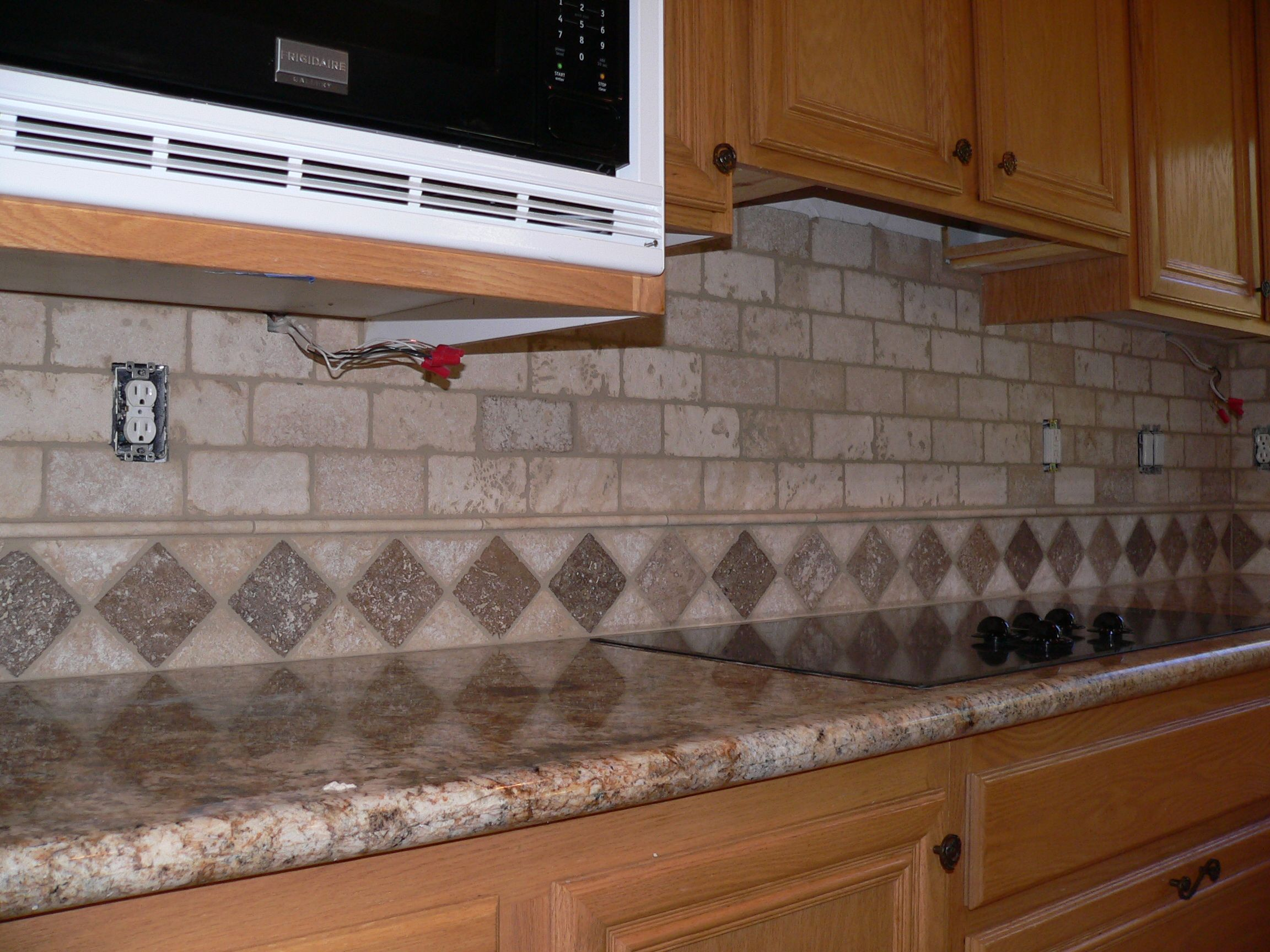 Travertine tile backsplash kitchen backsplash make over for Travertine tile designs