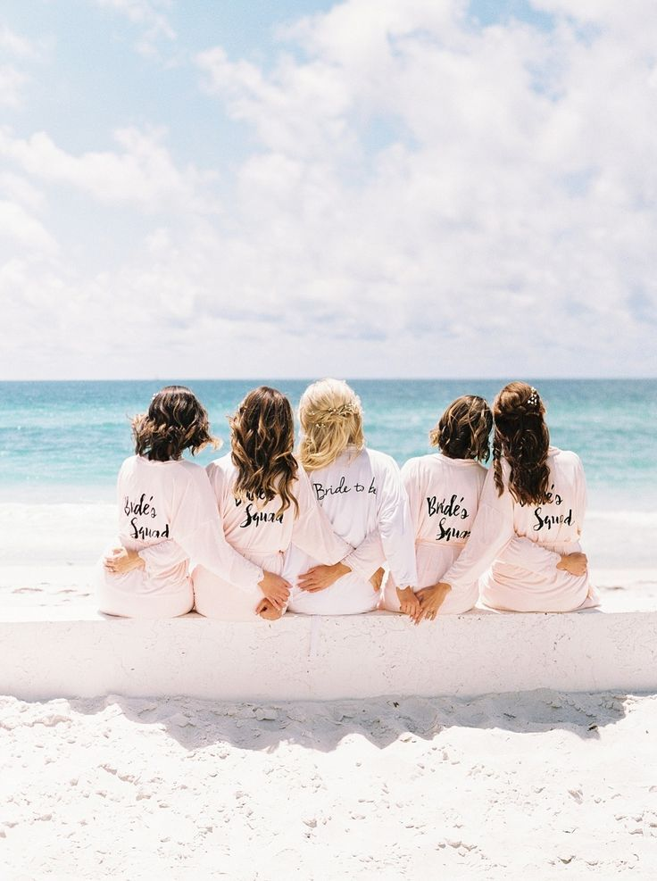 a bridal party on the beach, bridesmaid pjs robes, Anna Maria island, Florida destination wedding