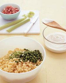 When this pasta salad arrived on the picnic table, and where it came from, is a mystery. It may have been an offshoot of another creamy summer salad, the potato kind. Crisp celery, peas, and scallions punctuate this version, which is sprinkled with bits of ham and ground pepper and nutmeg.