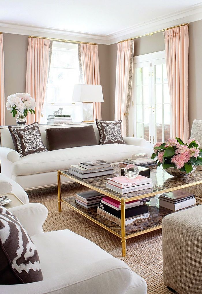 neutral taupe walls, blush pink accents, very elegant living room