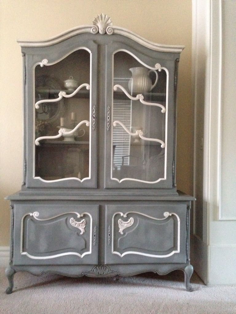 A Beautiful China Cabinet. Chalk Painted In Gray With Two Tone High And Low  Grays Added.