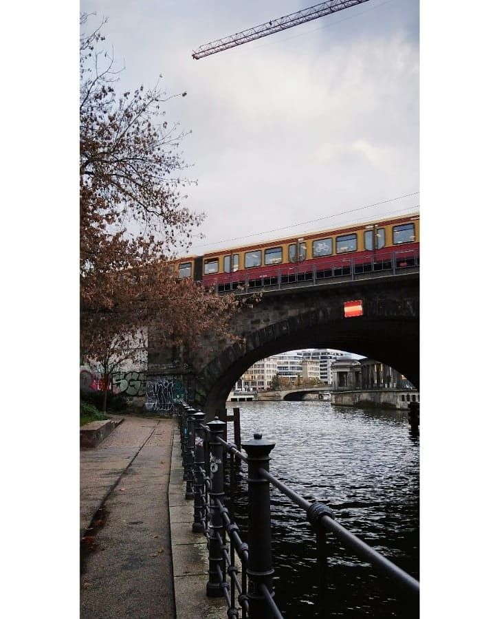 To trip: experience everyday things as if for the first time 🧭 #tbt #trip #vacations #germany #berlin #november2019 #river #train #grey #cloudyday #underconstruction