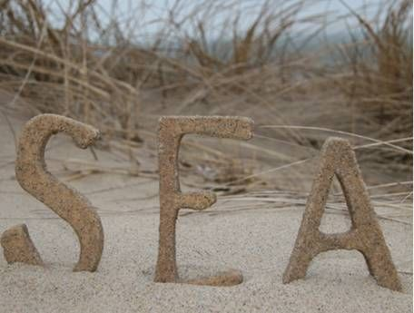 make beach sand letters with paper mache or wooden letters from the craft store