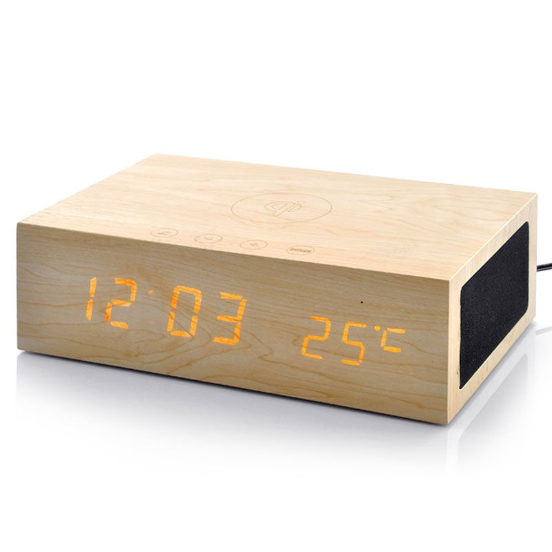 Cool Bluetooth Alarm Clocks Bluetooth Speaker Qi Wireless - Clever magnetic wall clock charges phone wirelessly
