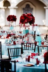 Red rose centerpieces on Tiffany blue table setting #celebstylewed #weddings @celebstylewed
