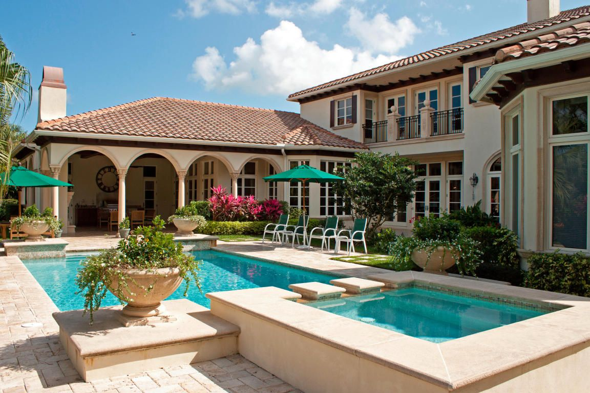 Poolside at this Mediterranean style luxury home for sale