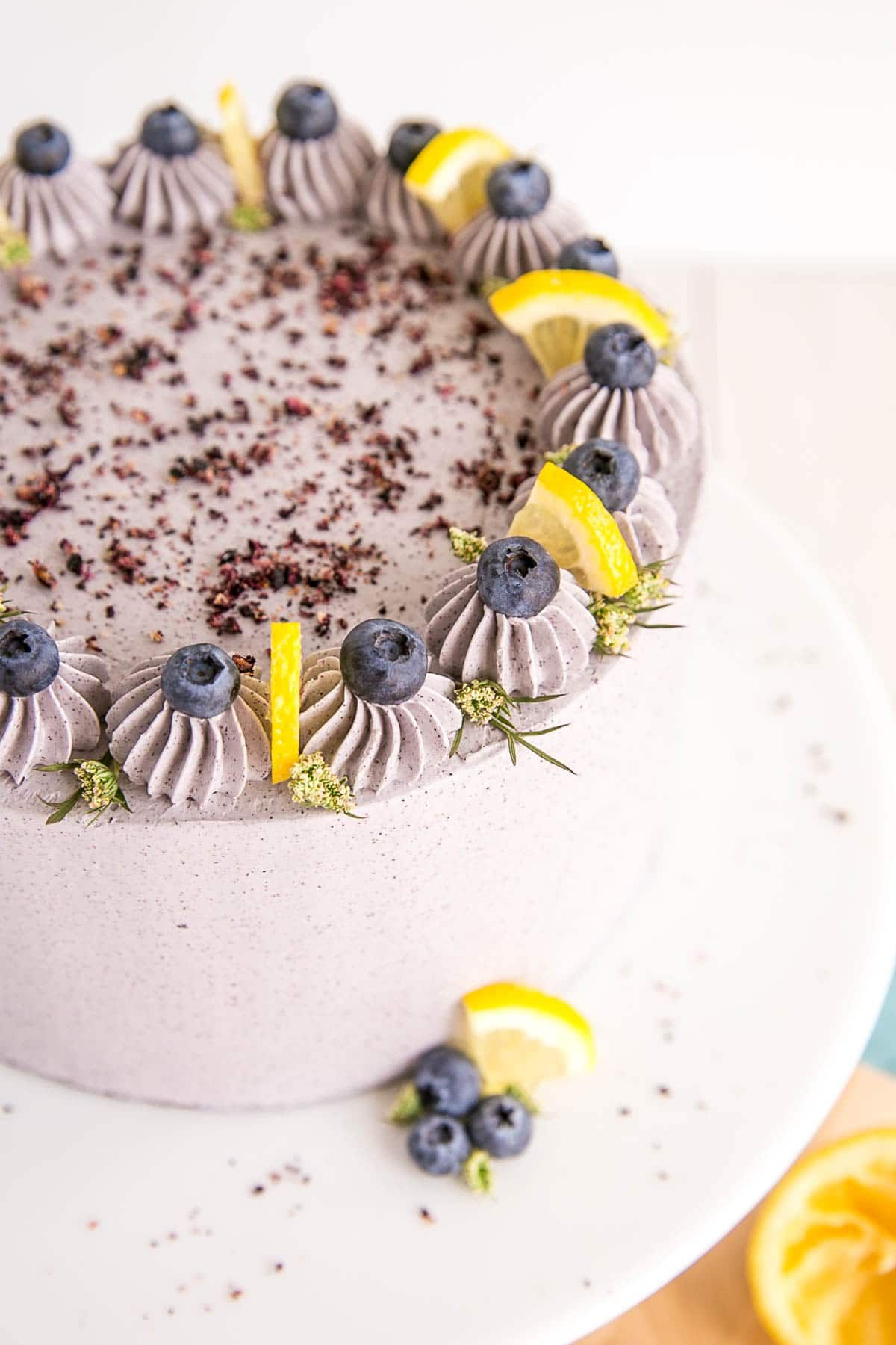 Lemon Blueberry Cake A Moist And Delicious Lemon Cake With Fresh Blueberries And A Blueberry Buttercr Blueberry Lemon Cake Blueberry Cake Delicious Lemon Cake