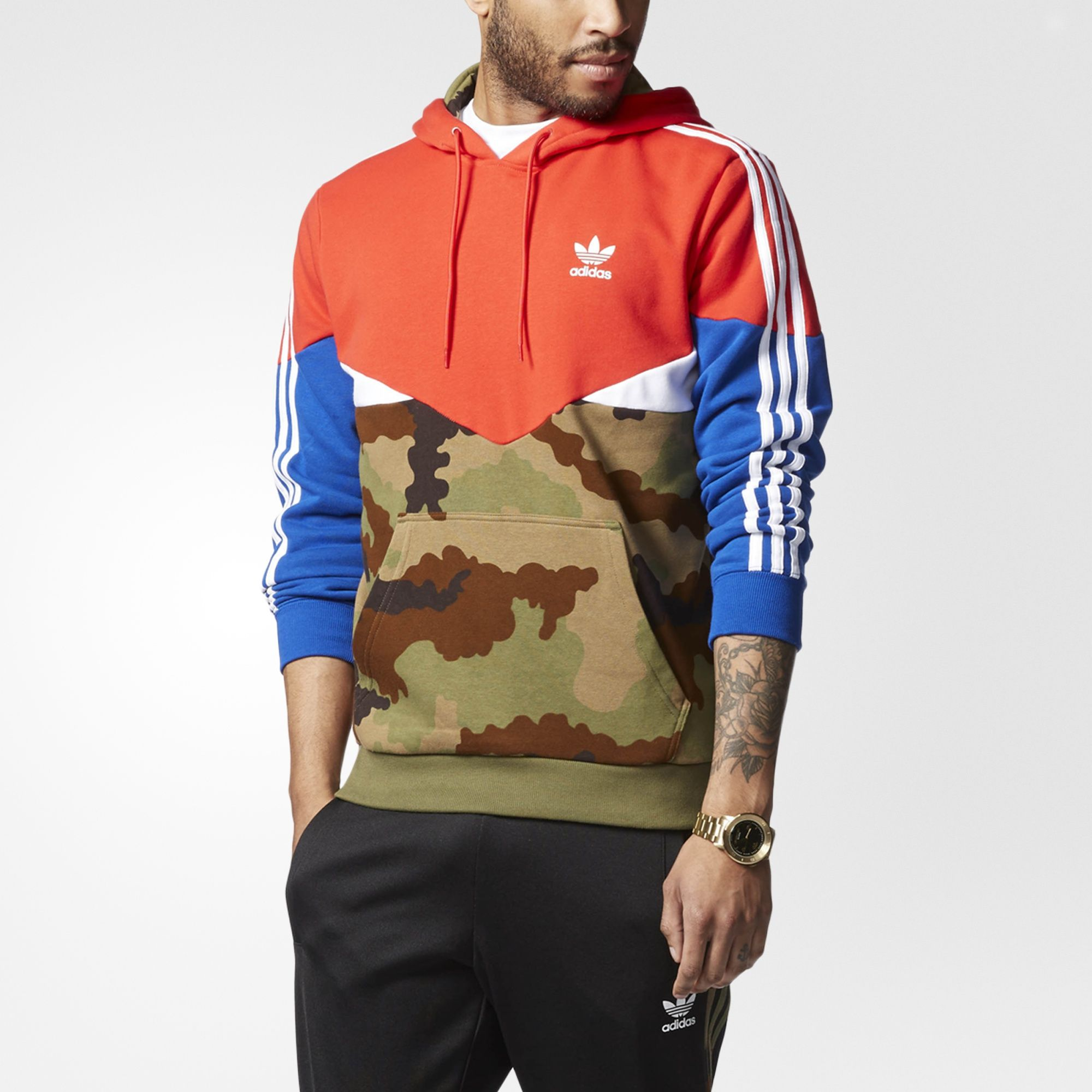 Bring back a classic archival look with this men's hoodie. Primary colors  and camouflage graphics