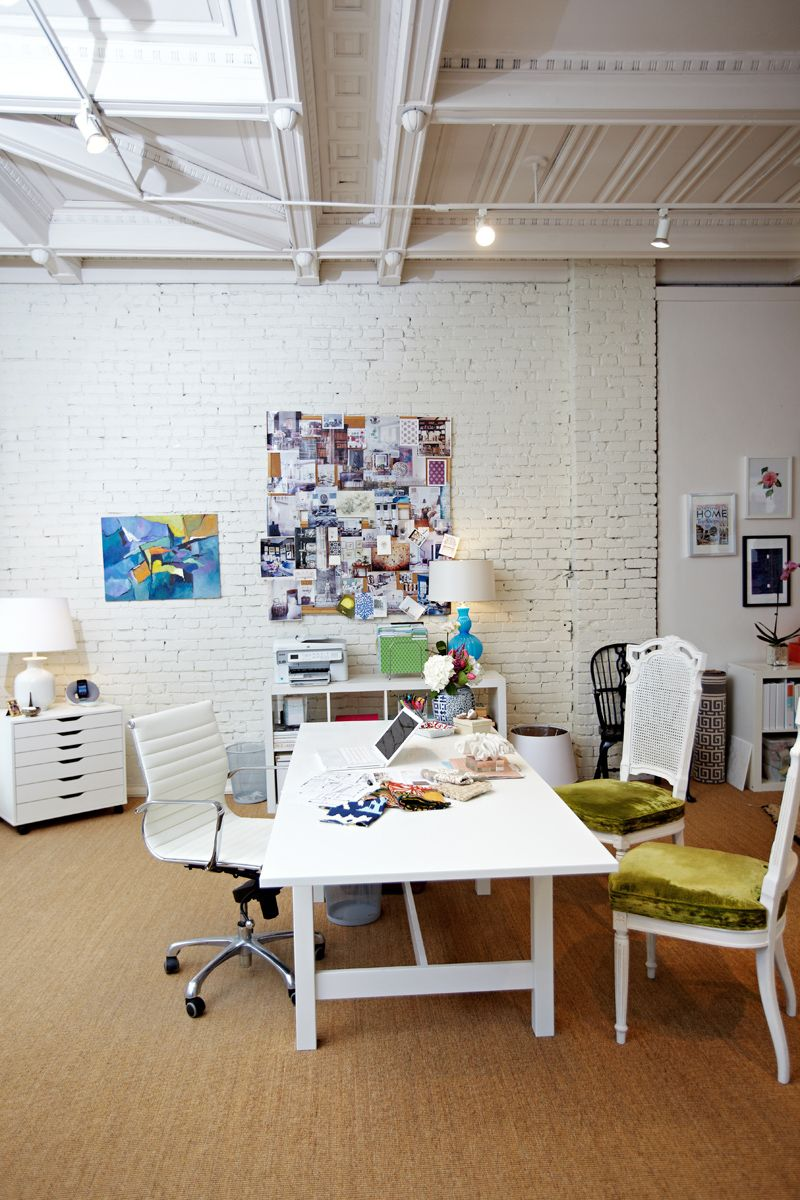 love this workspace: white brick, huge desk and pops of colour