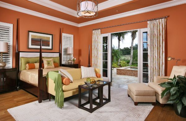 Dash Of Green And Yellow To Go Along With All The Orange In The Modern Bedroom Decor Bedroom Design Soothing Bedroom Colors