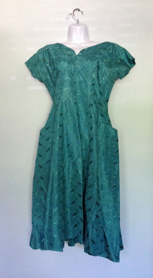Emerald green 1950's cocktail dress. Great by blackhairblackheart