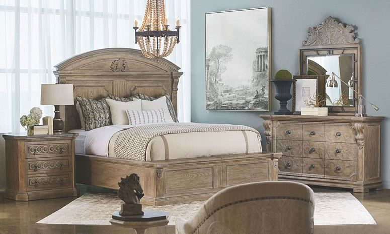 5 piece bedroom collection features queen paneled headboard and footboard 9 drawer dresser and mirror with architectural salvage appeal