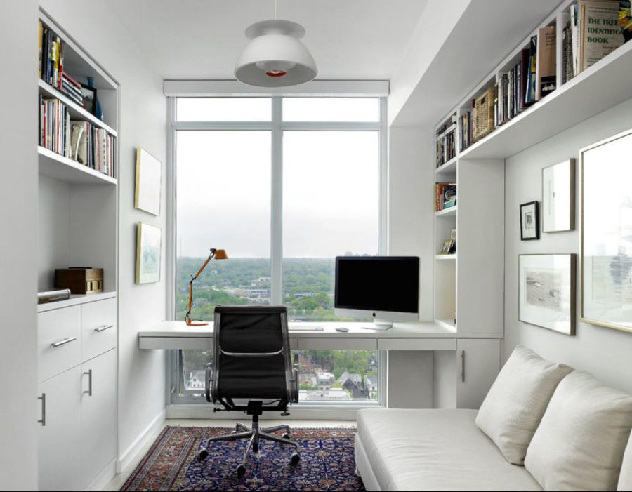 Photo of modern white home office with a view