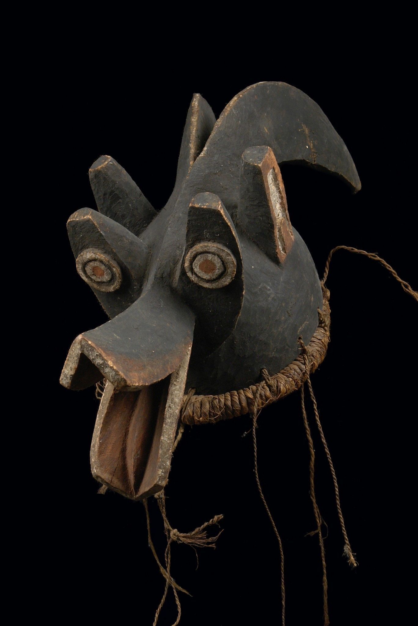 Cameroon, Mambila -  wood, matt black patina, camwood powder and kaolin, carved with elegant curved horns and funnel-shaped snout, grass fibre tube at the lower rim, pierced around the rim, min. dam., slight traces of abrasion