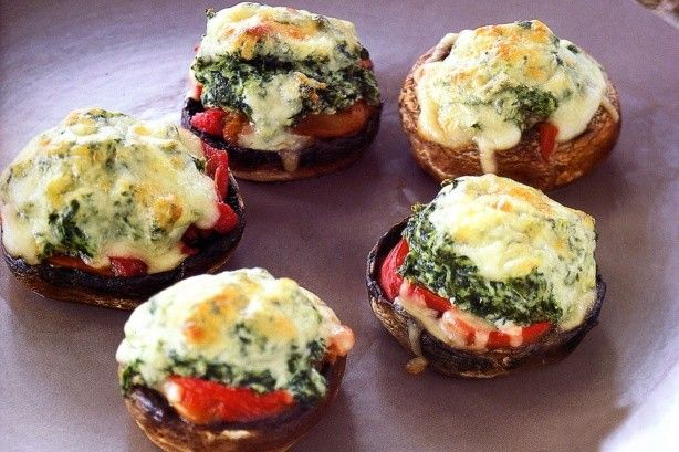 Portobello mushrooms with garlicky tomatoes, spinach and ricotta