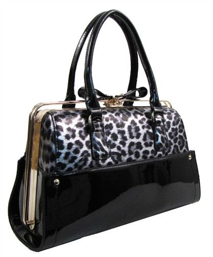 This slide-lock framed handbag features double handles, a slide lock closure, interior pocket with zip closure, and detachable shoulder strap. 13 (W) x 5.5 (D) x 9 (H) Inches
