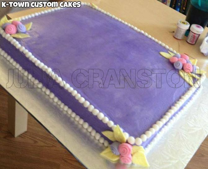 This is a standard slab cake before the finalized icing details.