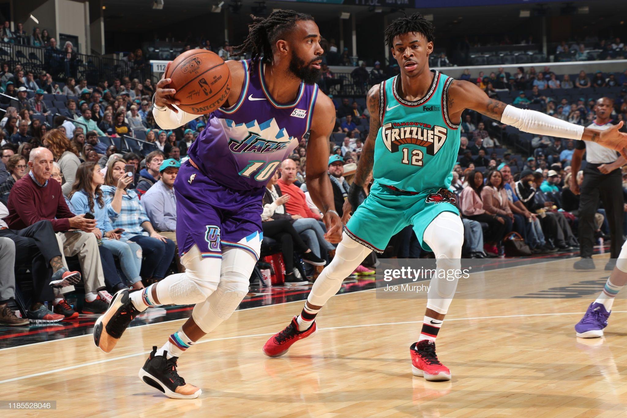 Mike Conley Of The Utah Jazz Handles The Ball Against The Memphis Utah Jazz Memphis Grizzlies Mike Conley